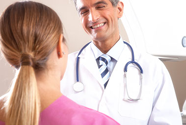 male doctor speaking with female patient undergoing Clinical Outcomes