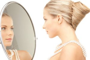 beautiful woman with pearl beads and mirror, How Acne Treatments Works