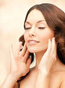 face, hands, woman,Laser face treatments, Woman holding face